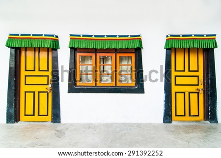 Colorful doors and window in a Buddhist monastery in Darjeeling, India - stock photo