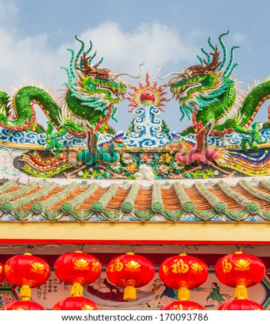 Colorful dragon on roof in Chines temple - stock photo