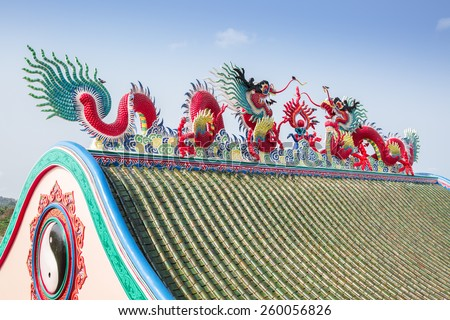 Colorful dragon on roof in chinese temple - stock photo