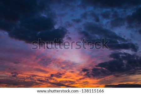 colorful dramatic sky with cloud at sunset - stock photo