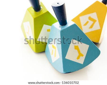 Colorful dreidels on white background.