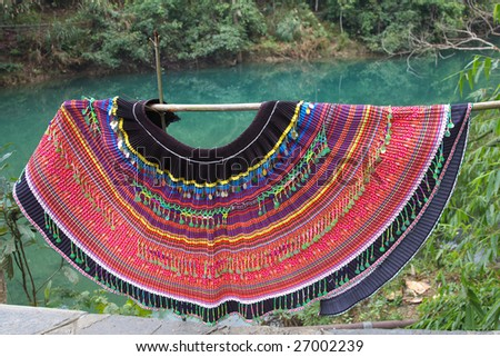Colorful dress of chinese minority - stock photo