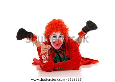 Colorful dressed female holiday clown, happy joyful expression on face. Studio shot.