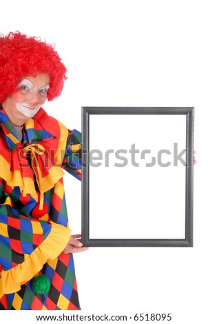 Colorful dressed female holiday clown with with advertising board, happy joyful expression on face, copy space