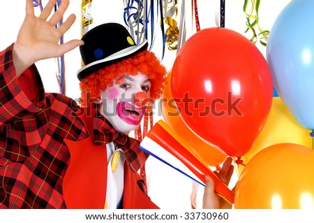 Colorful dressed male holiday clown with balloons, happy joyful expression on face. Studio shot. - stock photo