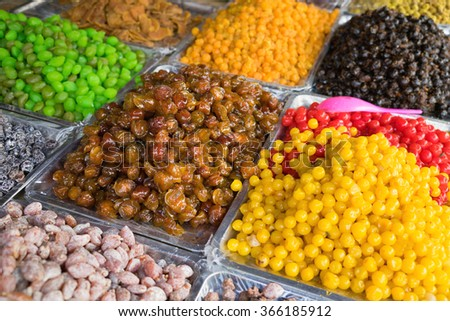 Colorful dried salted or sugared Asian tropical fruits
