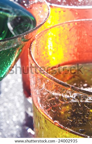 Colorful drinks on a reflective tabletop. - stock photo
