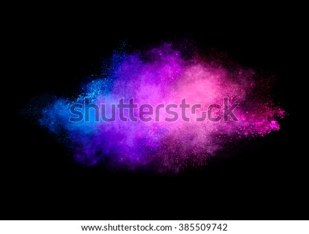 Colorful dust particle explosion resembling a pyrotechnic effect. Closeup of a color explosion isolated on black - stock photo