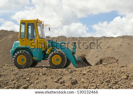 colorful earth moving digger - stock photo
