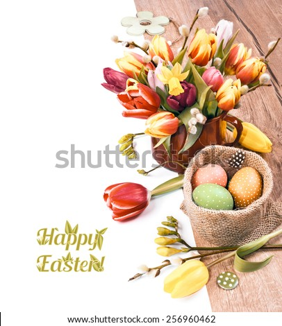 Colorful Easter border with bunch of tulips and Easter eggs on wood, white background, deep DOF, space for your text. This image is toned. - stock photo