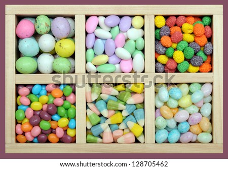 colorful Easter candy in wooden tray - stock photo