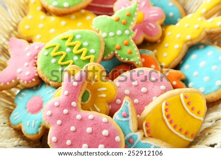 Colorful easter cookies in basket - stock photo