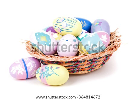 Colorful Easter eggs and basket on a white background