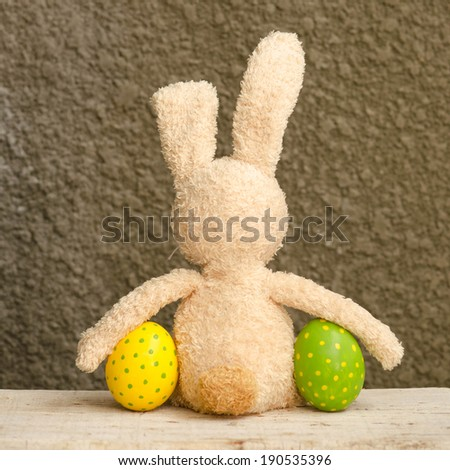 Colorful easter eggs and rabbit - stock photo