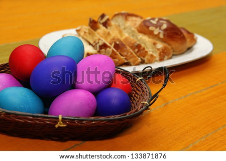 Colorful easter eggs and sponge cake on a table