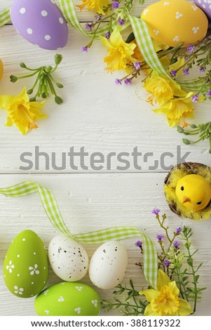 colorful easter eggs and spring flowers frame background - stock photo
