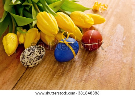 Colorful Easter eggs and tulips.