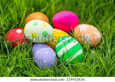 Colorful Easter eggs decorated in the grass  - stock photo