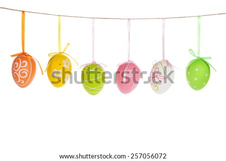 Colorful easter eggs hanging on rope. Isolated on white background - stock photo