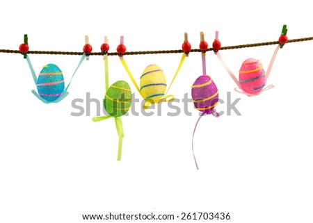 Colorful easter eggs hanging on rope isolated on white background - stock photo