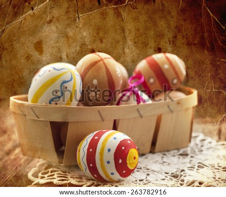 Colorful Easter eggs in a little basket. Easter background, spring themes - stock photo