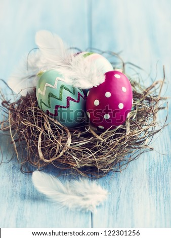 Colorful easter eggs in a nest - stock photo