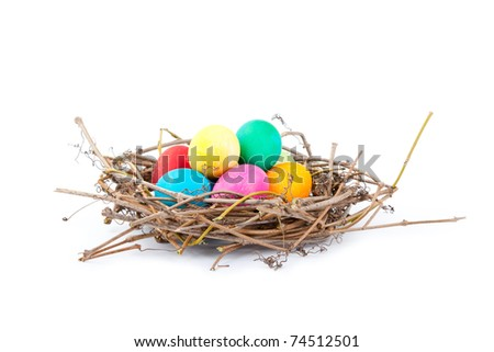 Colorful Easter eggs in a nest from branches on a white background, Spring Image. - stock photo
