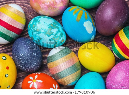 Colorful easter eggs in a wooden table - stock photo