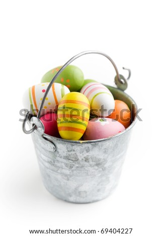 Colorful easter eggs in bucket, isolated on white - stock photo