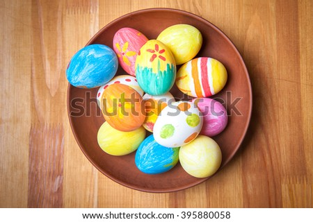 Colorful Easter Eggs In Plate Easter Day. Family Preparing For Easter.