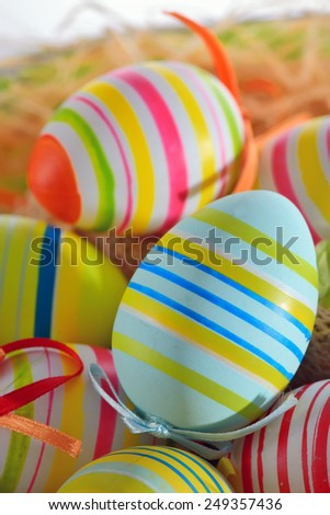 Colorful easter eggs isolated in basket - stock photo