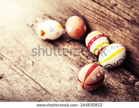 Colorful Easter eggs on beautiful wooden table, Easter background - stock photo