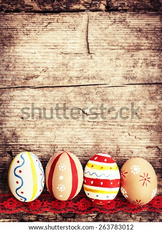 Colorful Easter eggs on old wooden table background with copy space, Easter background - stock photo