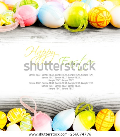 Colorful Easter eggs on wooden board - stock photo