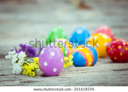 Colorful easter eggs on wooden floor - stock photo