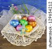 Colorful Easter eggs with blue rabbit made of clay - stock photo