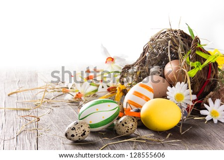 Colorful easter eggs with brown basket - stock photo