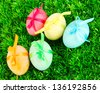 Colorful eastern eggs on  grass background - stock photo