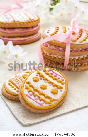 Colorful egg-shaped cookies for easter on the white background - stock photo