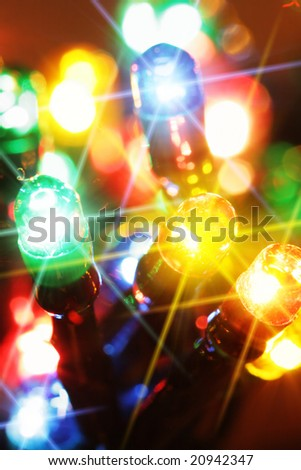 Colorful electric light bulbs close-up with glare