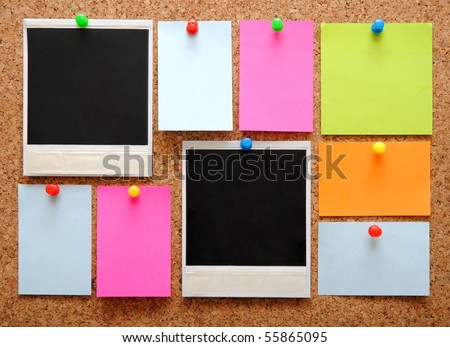 colorful empty notes and photo frames over brown cork background - stock photo