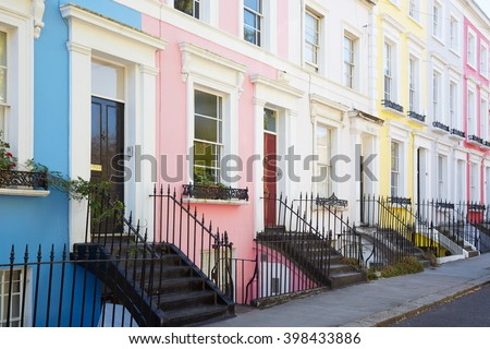 Colorful English houses facades in blue, pink, yellow and white colors in London  - stock photo