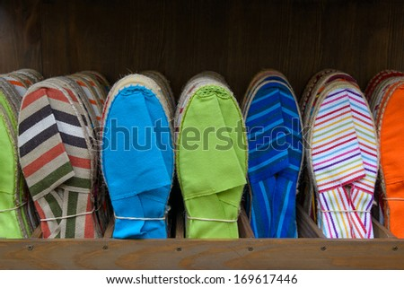 Colorful espadrilles for sale in a shop in the French Basque Country - stock photo