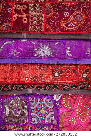 Colorful ethnic Rajasthan cushion cover on flea market in India - stock photo