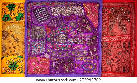 Colorful ethnic Rajasthan cushion covers on flea market in India - stock photo