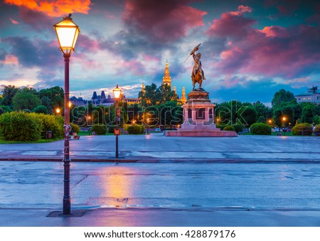 Colorful evening view of Town Holl and Monument of Erzherzog Karl. Beautiful outdor scene in Vienna, Austria, Europe. Artistic style post processed photo. - stock photo