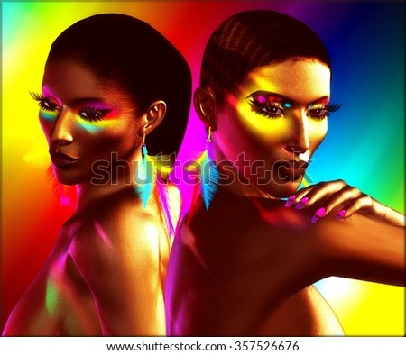 Colorful eye shadow, matching background, and feather earrings all come together to express these beautiful African digital models deep in thought. Perfect for beauty,fashion,cosmetics themes. - stock photo