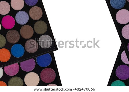 Colorful Eyeshadow. Closeup top view of makeup cosmetic palette isolated on white background with center copyspace