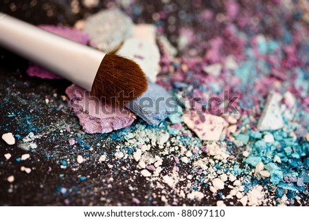 colorful eyeshadow powders and make-up brush