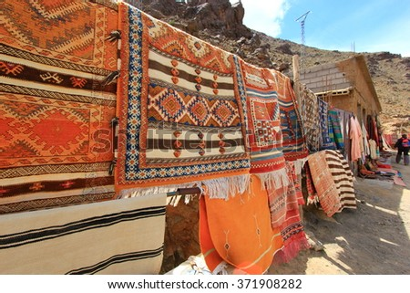 Colorful fabrics and carpets for sale on a street in Morocco, Marrakesh